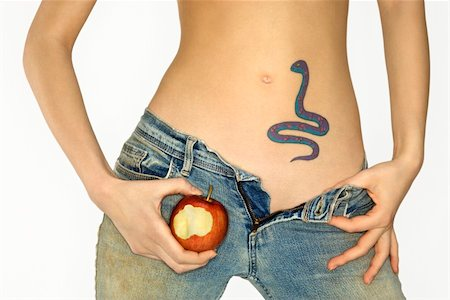 snake skin - Portrait of attractive Caucasian young woman holding apple by snake tattoo on stomach. Stock Photo - Budget Royalty-Free & Subscription, Code: 400-03925288
