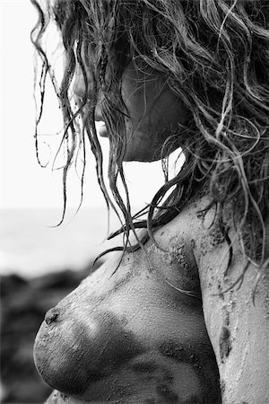 Profile of young adult Caucasian female nude covered in mud. Stock Photo - Budget Royalty-Free & Subscription, Code: 400-03925326