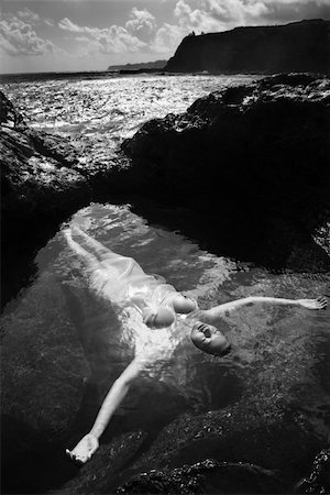 Young nude Asian woman floating in water with arms outstretched in Maui, Hawaii. Stock Photo - Budget Royalty-Free & Subscription, Code: 400-03925897
