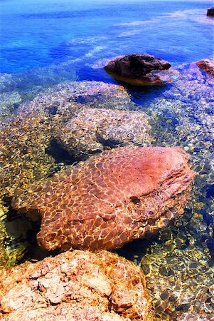 Background of rocks under clear inviting water Stock Photo - Budget Royalty-Free & Subscription, Code: 400-03920420