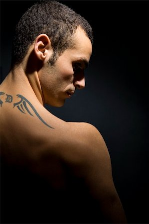 man seen from behind showing his tattoo on his shoulders Stock Photo - Budget Royalty-Free & Subscription, Code: 400-03922410