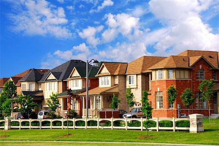Row of new residential houses in suburban neighborhood Stock Photo - Budget Royalty-Free & Subscription, Code: 400-03923361