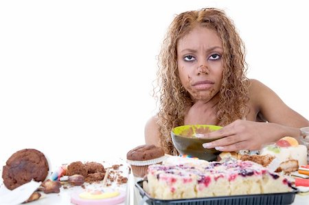 Pretty black girl feeling very ill after having eaten too much sweets Stock Photo - Budget Royalty-Free & Subscription, Code: 400-03936414