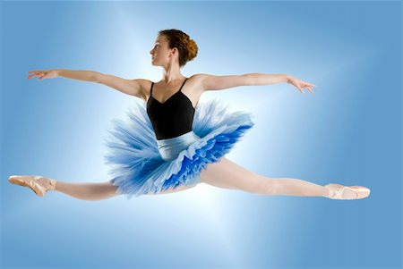 feet gymnast - dancer in blue tutu jumpig on a shining blue background Stock Photo - Budget Royalty-Free & Subscription, Code: 400-03931114