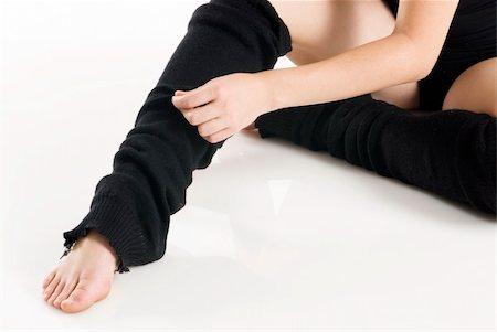 feet gymnast - legs in black knee socks warming up Stock Photo - Budget Royalty-Free & Subscription, Code: 400-03931115
