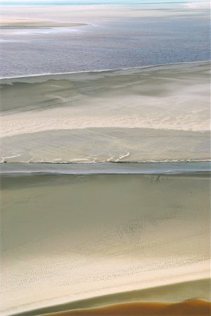 Aerial view of Atlantic ocean at low tide near Mont Saint Michel abbey in France. Background. Stock Photo - Budget Royalty-Free & Subscription, Code: 400-03931546