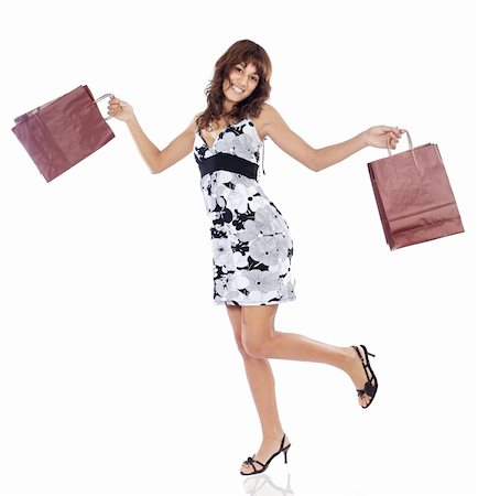 Shopping girl a over white background Stock Photo - Budget Royalty-Free & Subscription, Code: 400-03932303