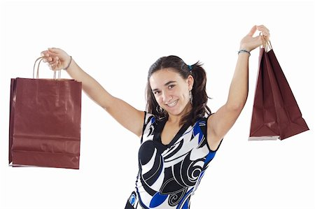 Shopping young girl a over white background Stock Photo - Budget Royalty-Free & Subscription, Code: 400-03932449