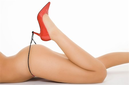 Very sexy Caucasian woman dressed in only red highheal shoes and a thong Stock Photo - Budget Royalty-Free & Subscription, Code: 400-03946789