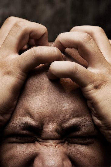 close up photo of a man having great painful stress and depression Stock Photo - Royalty-Free, Artist: beltsazar, Image code: 400-03947028