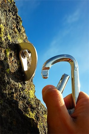 Hand attaching carabiner to a rock anchors Stock Photo - Budget Royalty-Free & Subscription, Code: 400-03947562