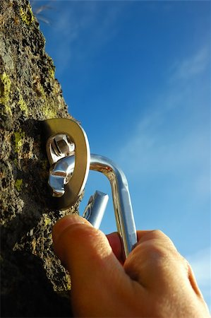 Hand attaching carabiner to a rock anchors Stock Photo - Budget Royalty-Free & Subscription, Code: 400-03947563