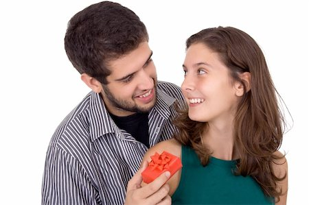 Young couple. Man giving a present to a beautiful young woman. Stock Photo - Budget Royalty-Free & Subscription, Code: 400-03940207