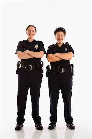 female police officer happy - Portrait of two mid adult Caucasian policewomen standing with arms crossed looking at viewer smiling. Stock Photo - Budget Royalty-Free & Subscription, Code: 400-03940749