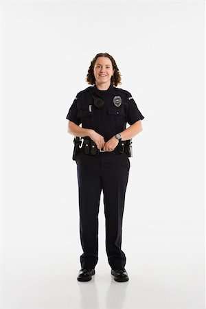 female police officer happy - Portrait of mid adult Caucasian policewoman standing with hands on gun holster looking at viewer smiling. Stock Photo - Budget Royalty-Free & Subscription, Code: 400-03940742