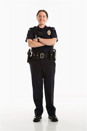 female police officer happy - Portrait of mid adult Caucasian female law enforcement officer standing with arms crossed looking at viewer smiling. Stock Photo - Budget Royalty-Free & Subscription, Code: 400-03940743
