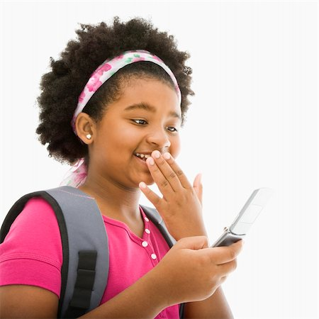 African American girl with backpack talking on cell phone. Stock Photo - Budget Royalty-Free & Subscription, Code: 400-03940967