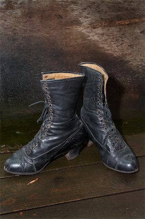 Old female boots on wooden to a floor Stock Photo - Budget Royalty-Free & Subscription, Code: 400-03943038