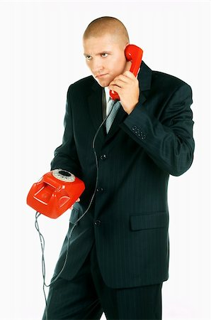 A Young businessman with red classic telephone Stock Photo - Budget Royalty-Free & Subscription, Code: 400-03954967