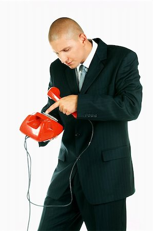A Young businessman with red classic telephone Stock Photo - Budget Royalty-Free & Subscription, Code: 400-03954968