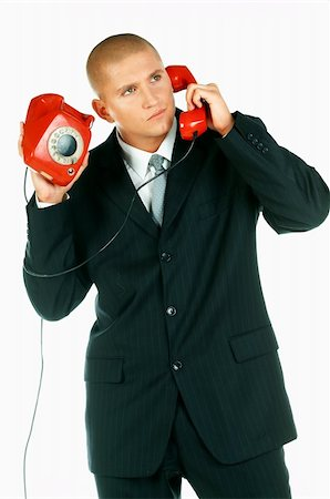 A Young businessman with red classic telephone Stock Photo - Budget Royalty-Free & Subscription, Code: 400-03954969