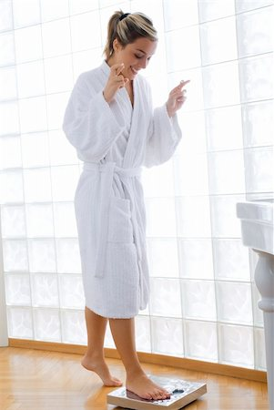 fat italian woman - young blond woman wearing a white bathrobe doing weight control in her bathroom Stock Photo - Budget Royalty-Free & Subscription, Code: 400-03955238