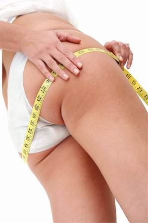 spanishalex (artist) - Woman with measuring tapelooking for cellulite Stock Photo - Budget Royalty-Free & Subscription, Code: 400-03957680