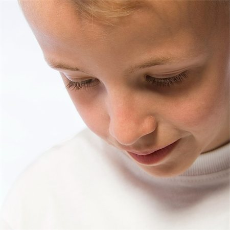 Portrait of a young boy in a dreamy pose Stock Photo - Budget Royalty-Free & Subscription, Code: 400-03965349