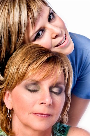 A portrait taken from mother and daughter taken on a white background Stock Photo - Budget Royalty-Free & Subscription, Code: 400-03965690