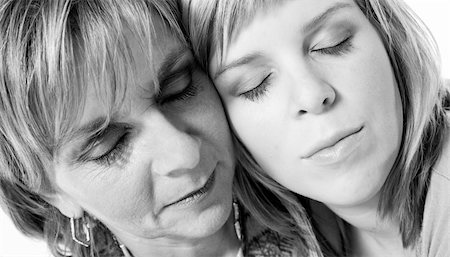 A portrait taken from mother and daughter taken on a white background Stock Photo - Budget Royalty-Free & Subscription, Code: 400-03965702