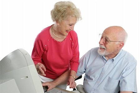 An attractive retired couple surfing the net together. Isolated Stock Photo - Budget Royalty-Free & Subscription, Code: 400-03969298