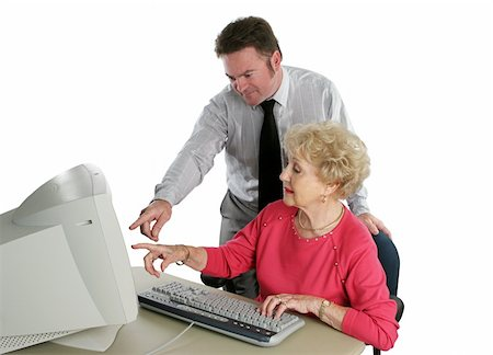 A senior lady taking computer lessons from an instructor. Stock Photo - Budget Royalty-Free & Subscription, Code: 400-03969346
