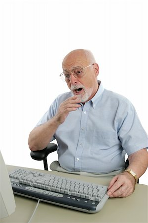 A senior man shocked by something he has seen online. Stock Photo - Budget Royalty-Free & Subscription, Code: 400-03969367