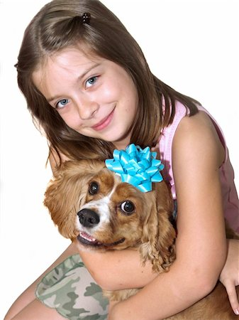 dog kissing girl - a little girl hugging her spaniel dog - isolated Stock Photo - Budget Royalty-Free & Subscription, Code: 400-03969754