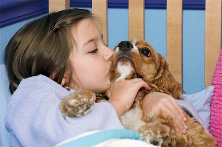 dog kissing girl - a little girl giving her puppy a kiss goodnight Stock Photo - Budget Royalty-Free & Subscription, Code: 400-03969778