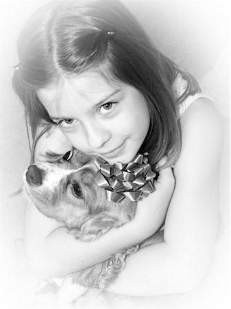 dog kissing girl - a little girl hugging her dog Stock Photo - Budget Royalty-Free & Subscription, Code: 400-03969793