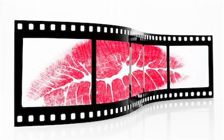 simsearch:400-04597082,k - Old Grainy film strip with lipstick kiss Stock Photo - Budget Royalty-Free & Subscription, Code: 400-03961049