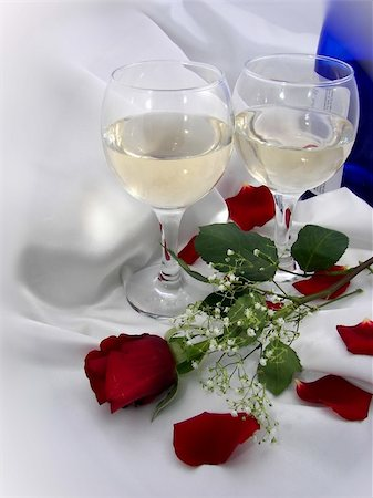 Pair of wine glasses and a red rose on white satin. Stock Photo - Budget Royalty-Free & Subscription, Code: 400-03974332