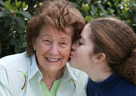 A girl giving her grandmother a kiss on the cheek Stock Photo - Budget Royalty-Free & Subscription, Code: 400-03970449