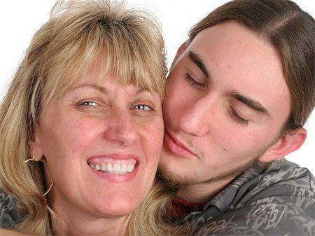 A teenaged young man giving his mother a kiss on the cheek. Stock Photo - Budget Royalty-Free & Subscription, Code: 400-03970483