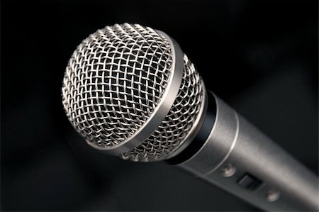 an extreme closeup view of a microphone on a black background Stock Photo - Budget Royalty-Free & Subscription, Code: 400-03971041