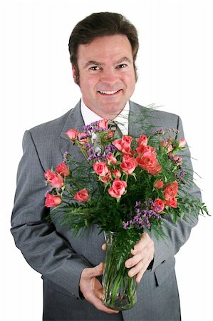 dozen roses - A handsome businessman holding a bouquet of roses for his wife, girlfriend, or secretary. Stock Photo - Budget Royalty-Free & Subscription, Code: 400-03972275