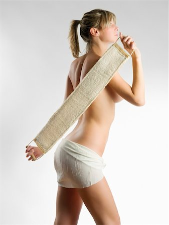 young blond woman scrubbing her shoulder after a shower Stock Photo - Budget Royalty-Free & Subscription, Code: 400-03983467