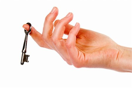 A concept image of a womans hand holding a key, dangling on one finger. Isolated on white with clipping mask. Stock Photo - Budget Royalty-Free & Subscription, Code: 400-03983607