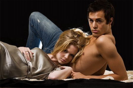 Attractive young blond woman laying on the bare chest of attractive young brunette man Stock Photo - Budget Royalty-Free & Subscription, Code: 400-03992483