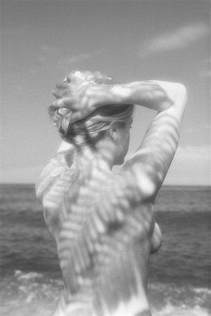 Nude woman in ocean Stock Photo - Premium Royalty-Free, Code: 604-00225693