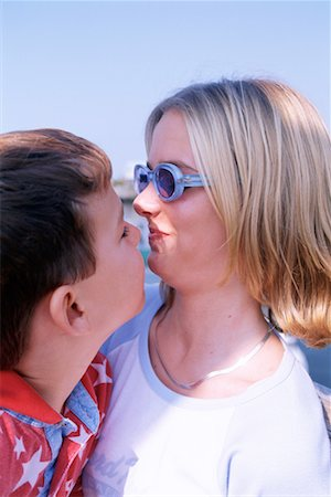 preteen kissing - Mother and son Stock Photo - Premium Royalty-Free, Code: 604-00228659
