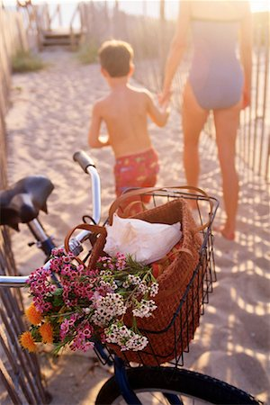 Mother and son with bicycle on beach Stock Photo - Premium Royalty-Free, Code: 604-00228903