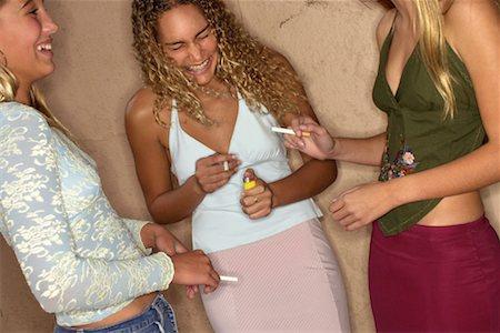 Teenage girls smoking Stock Photo - Premium Royalty-Free, Code: 604-00229558