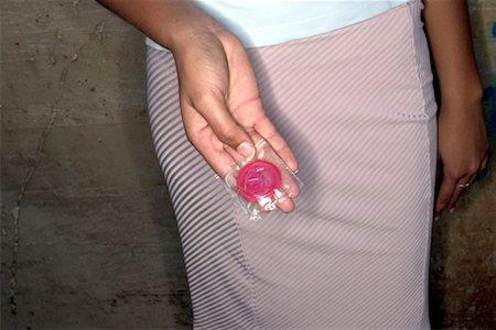 Hand holding condom Stock Photo - Premium Royalty-Free, Code: 604-00229582